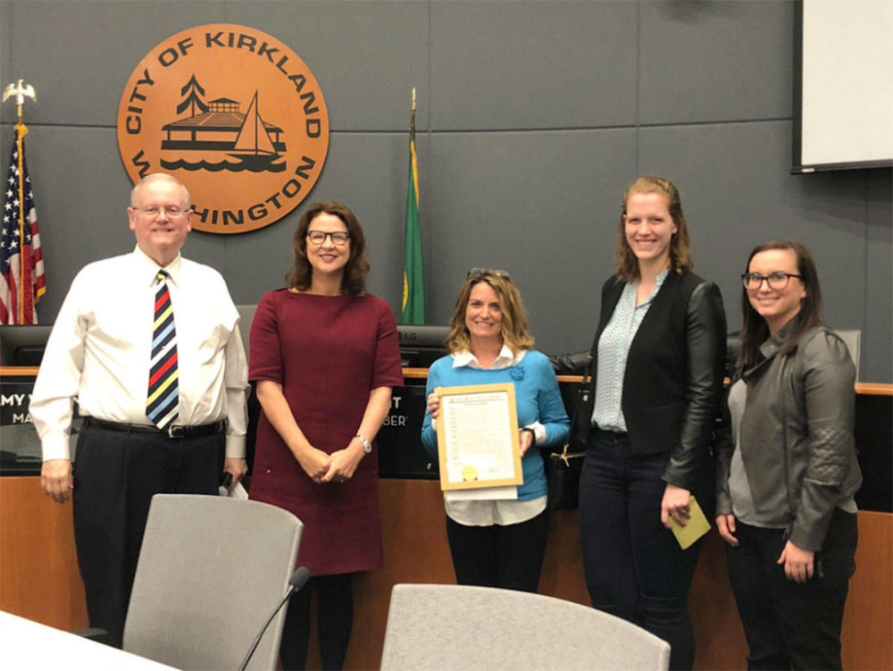 """Kirkland City Council member Toby Nixon and Mayor Amy Walen present a proclamation for """"Affordable Housing Week"""" to Cassandra Sage, Amber Gmerek and Joy Horbochuk on May 1. Photo via Twitter"""
