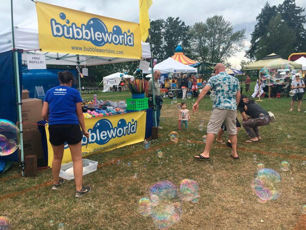 Families play with bubbles in the KidZone at Kirkland Summerfest on Aug. 11. Katie Metzger/staff photo