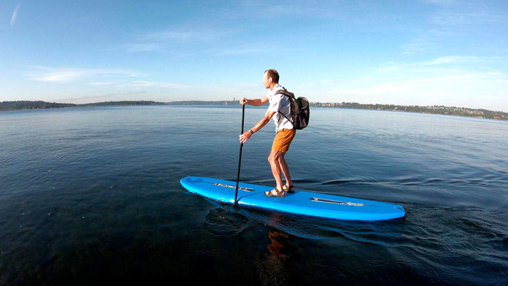 Paddleboarding is one way Bruce Dawson has commuted to work this month. Photo courtesy of Bruce Dawson