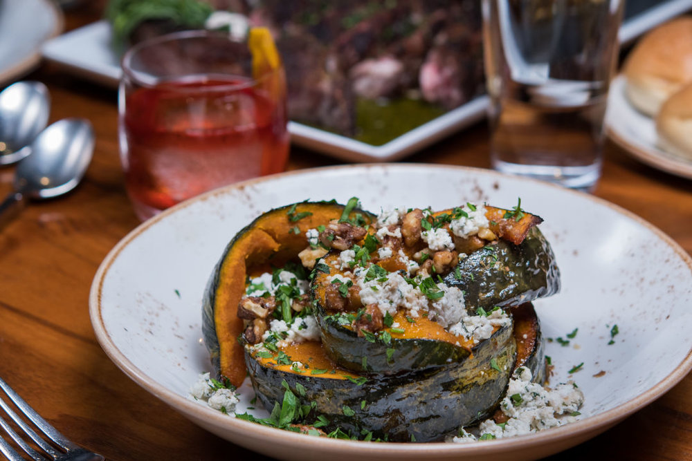 Thanksgiving at Miller's Guild features autmnal pickings like roasted delicata squash.  IMAGE:  COURTESY FIRE AND VINE HOSPITALITY