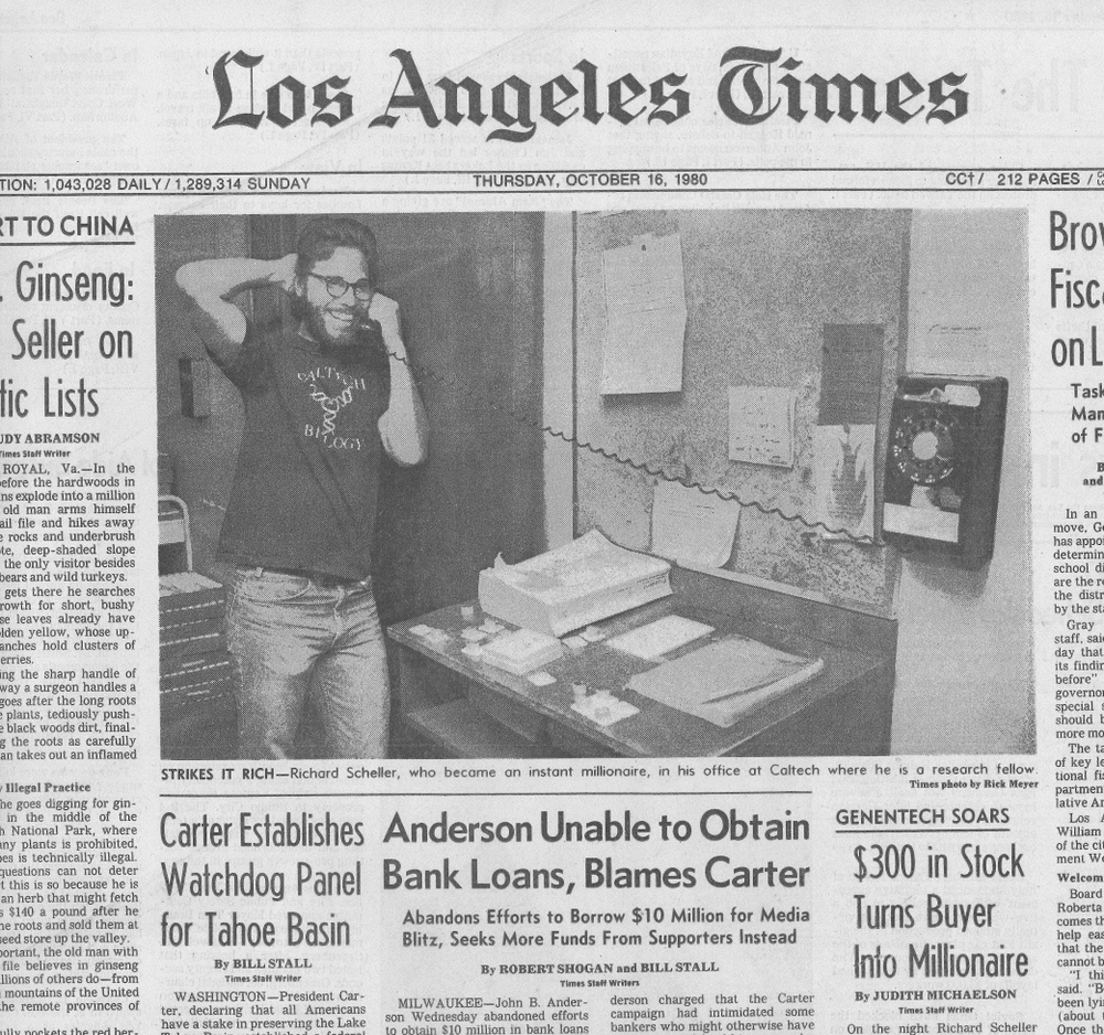 Scheller, wearing a Caltech Biology t-shirt, was featured on the front page of the LA Times when Genentech went public. His initial investment of $300 turned him into an overnight millionaire. ( Read Article )