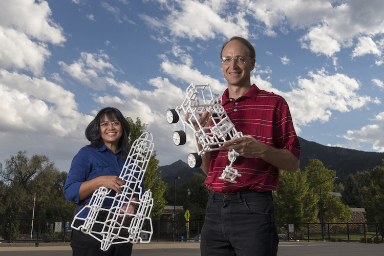 Monica (BS '95) and Charles Sharman (BS '95) with models built using Crossbeams. Photo: Glenn Asakwa