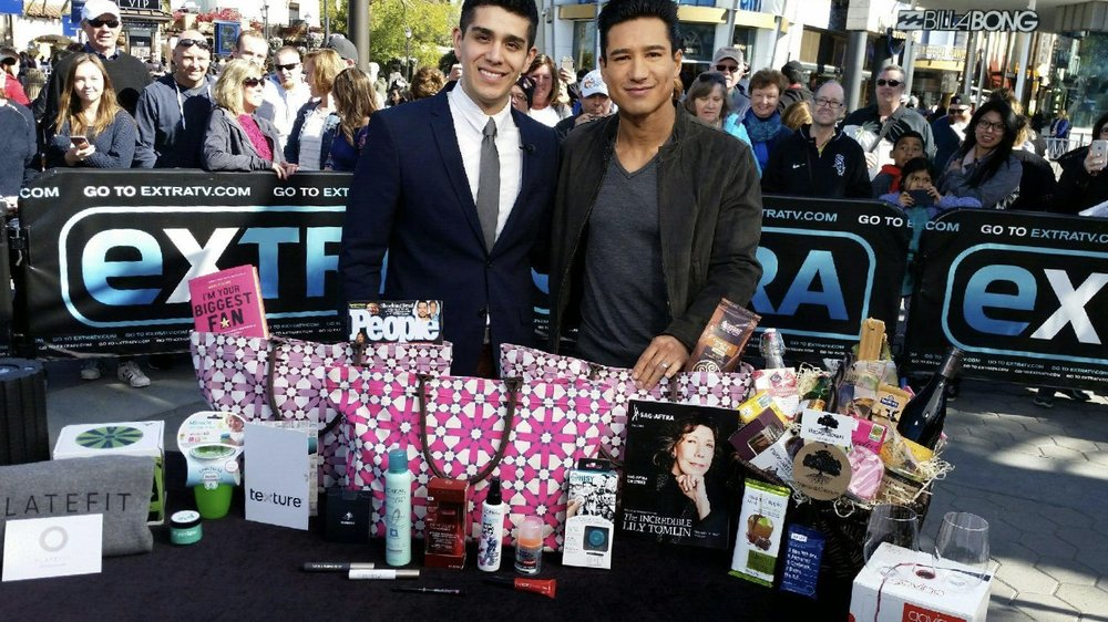 Mario Lopez and Patrick Gomez on the set of Extra! speaking about the official SAG Awards gift bag
