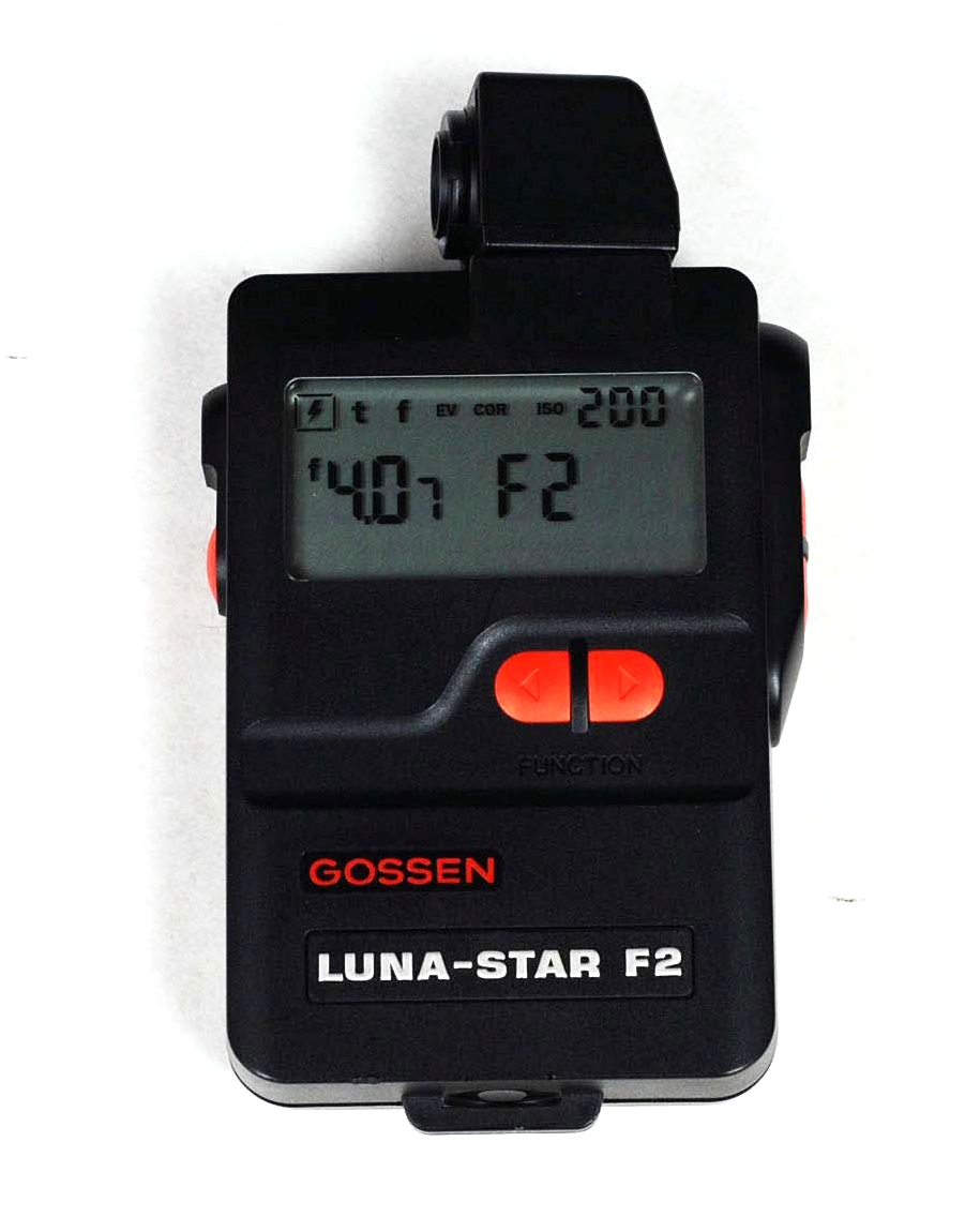 Gossen Luna-Star exposure meter.  Yes, it's ancient. Yes, it's less important now that digital cameras let you instantly review the shot. But it does read ambient and flash exposure, and it's really useful for setting up multiple lights.