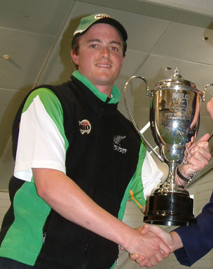 Chris 'the new guy' Ferguson holding a trophy