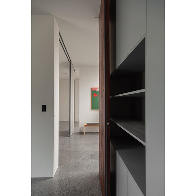 An open-plan interior loosely divided by walls, cabinetry and full-height doors. Art is by @grantjackstudio . . . . #NZarchitecture #moderndesign #art_chitecture #modernhouse #design #interiordesign #interiorstyle #architecturephotography #architektur #construcción #modern #architecturemoderne #modernarchitecture #contemporaryarchitecture #arquitecturaydiseño #interiors #interiorsinspo #architecturelovers