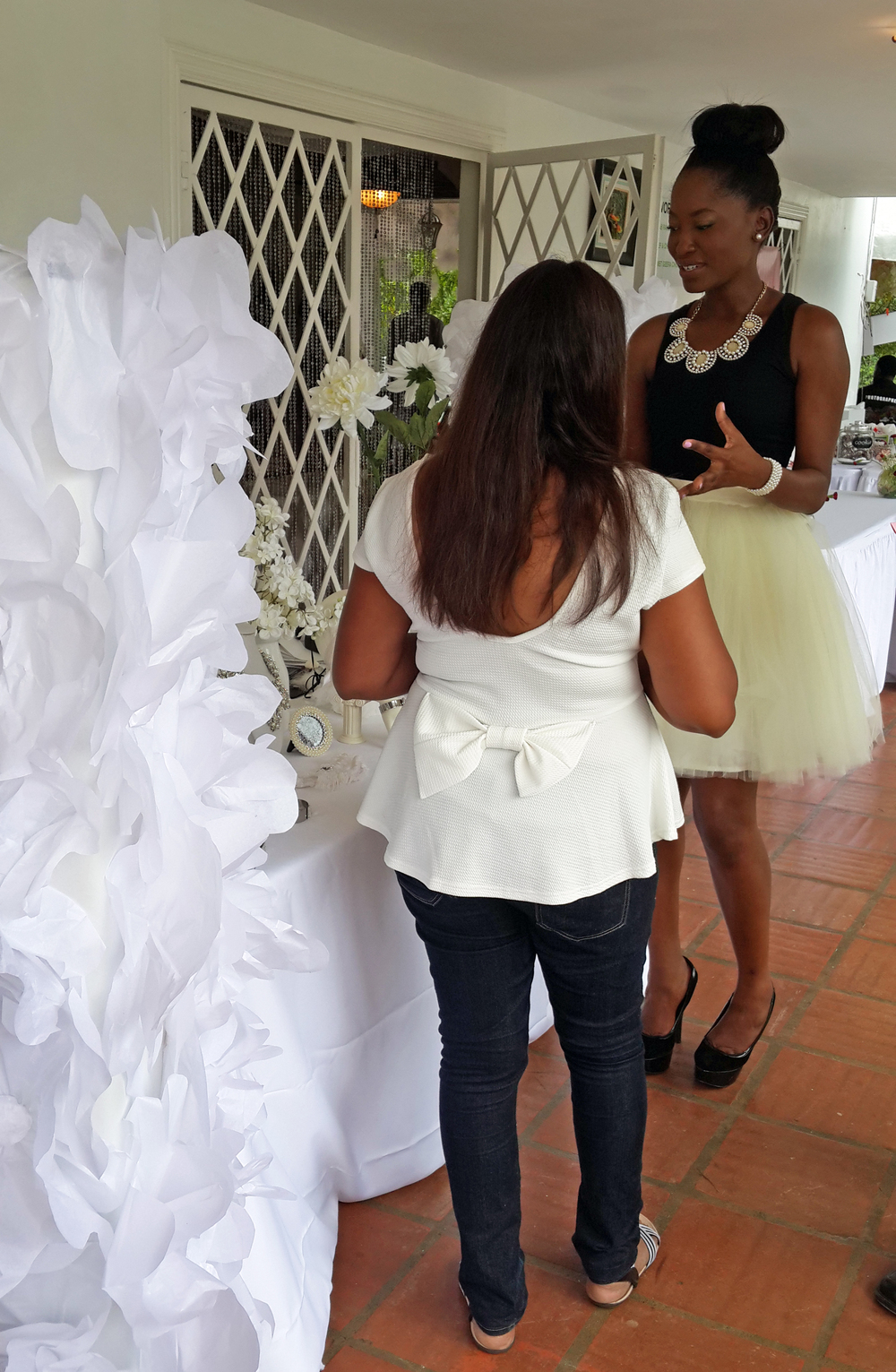 Shaunelle. Table display design by Shaunelle Ramesar. Assistant for the day interacting with patrons.