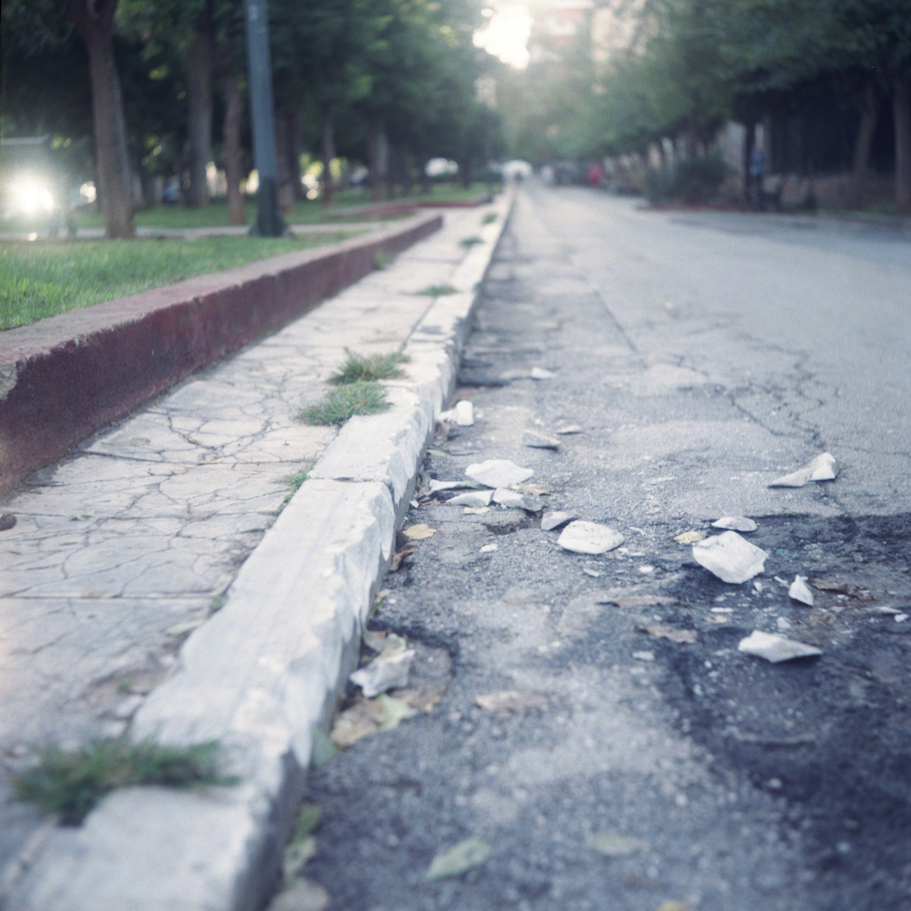 The marble on the streets are damaged during protests outside the university.