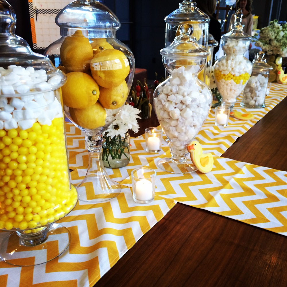 Decorative jars filled with candy and lemons and bright chevron runners