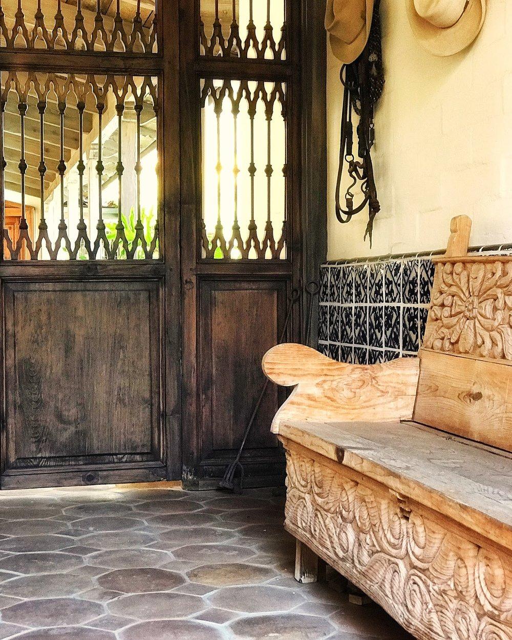 Pierced walnut entry doors that lead to the hacienda's inner courtyard