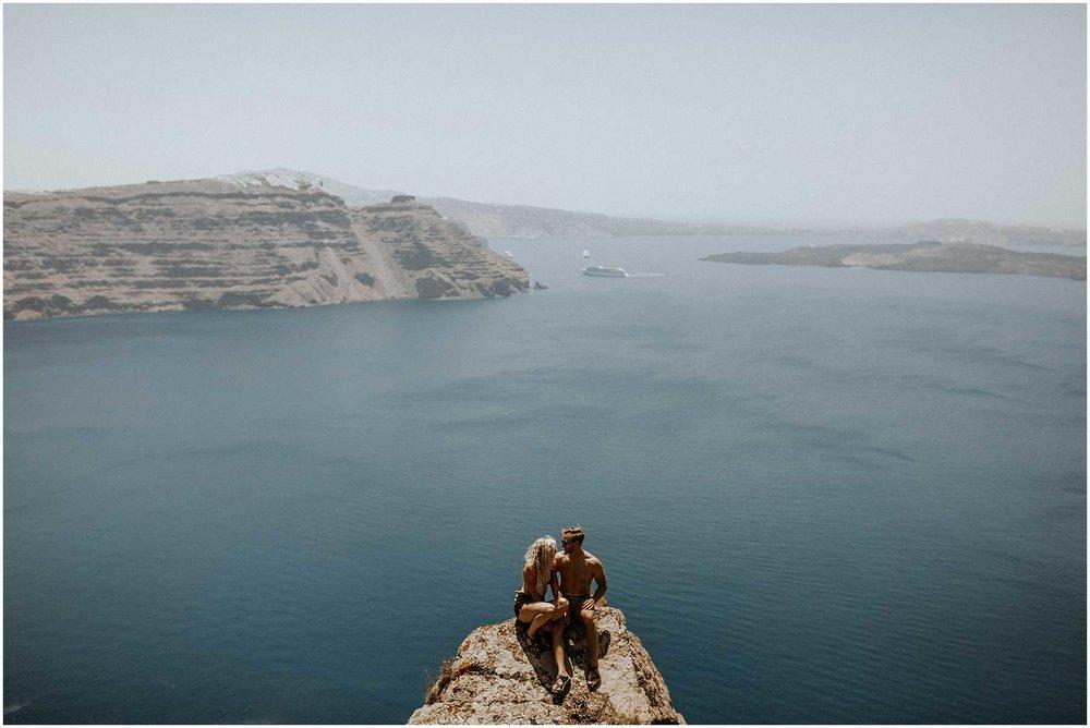 An adventurous couple hiking in Santorini Greece