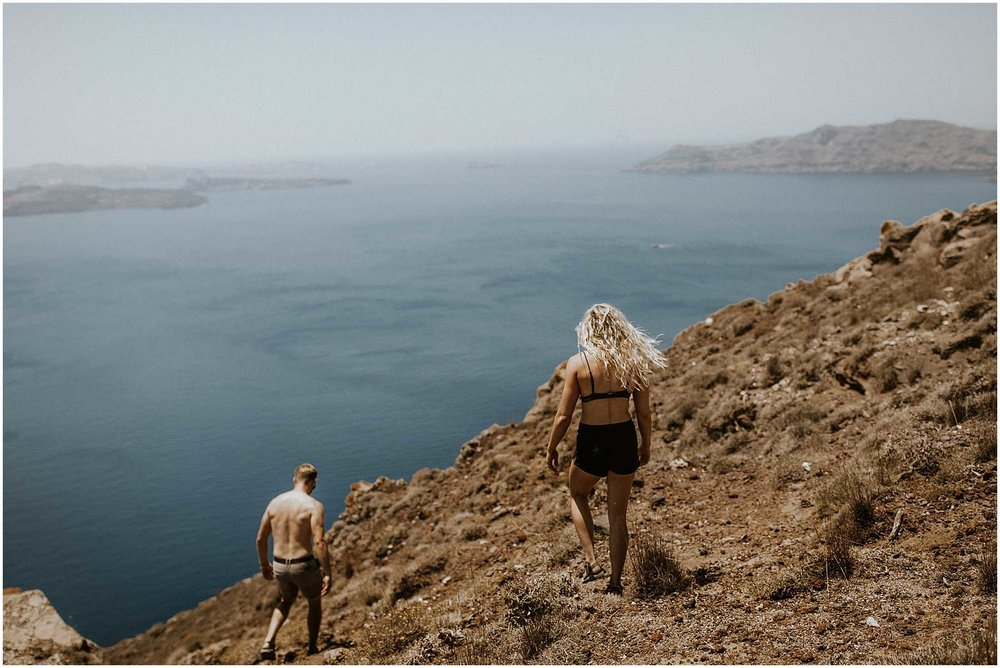 A couple hiking to Oia in Santorini Greece