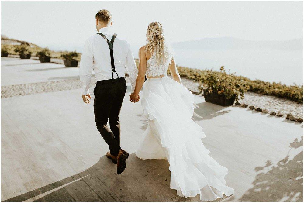 A couple at their wedding in Santorini Greece