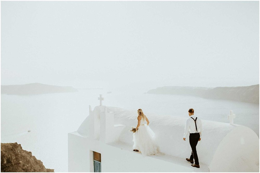 A bride and groom eloping in Santorini Greece