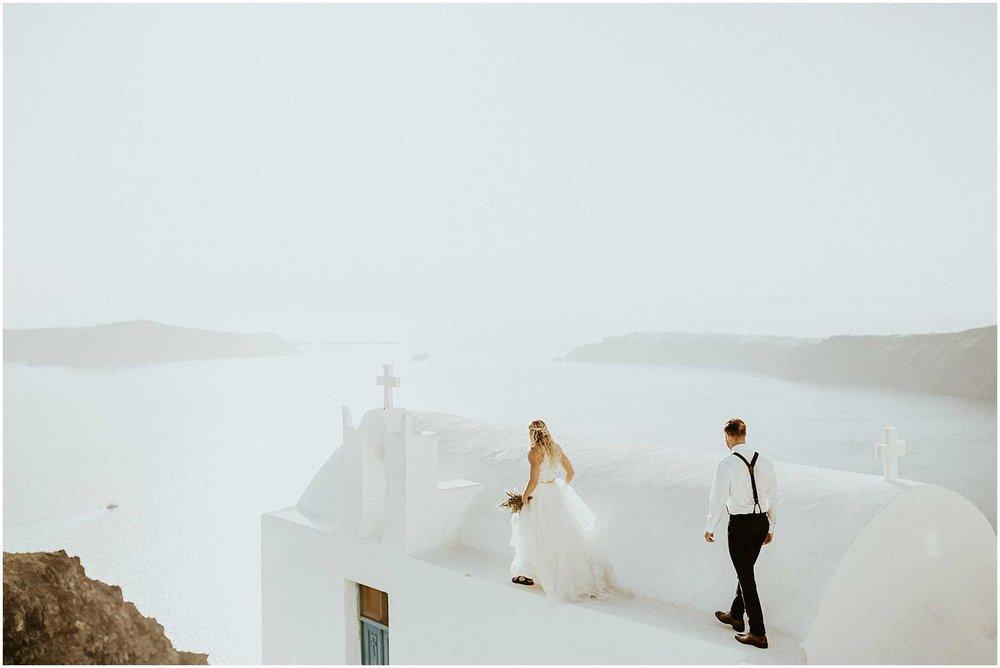 A bride and groom eloping in Santorini Greece