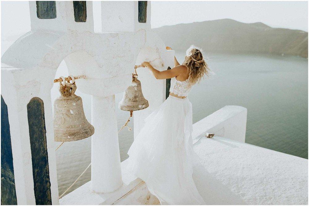 Ad adventurous bride on a church in Santorini Greece