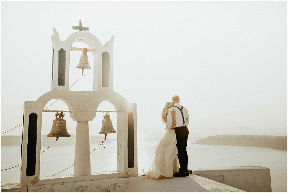 A couple elope on a church in Santorini Greece
