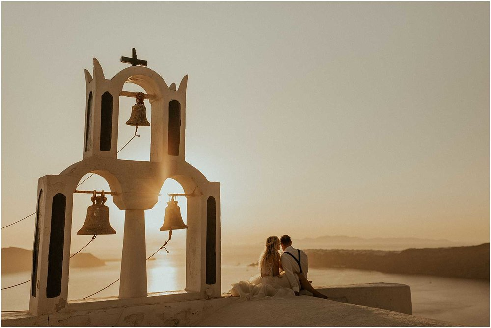 A sunset wedding is Santorini Greece