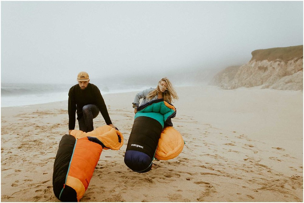 An adventurous couple spending their anniversary in Big Sur