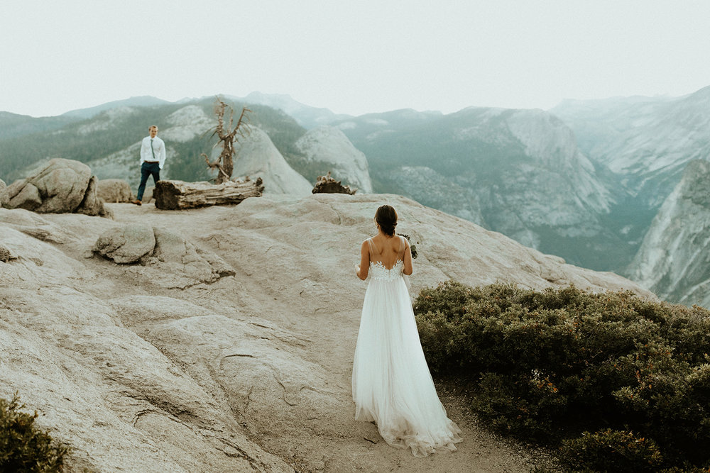 "Summer Elopement in Yosemite - ""I honestly don't know where to begin… Long story short, Anni is amazing, HIRE her! Having Anni as part of our intimate wedding was the best decision ever. She is beyond amazing and anyone who has her capture their wedding is very very lucky. When we first reached out to Anni, we were in a unique situation. We were living abroad at the time and my husband (then fiance) was waiting on his fiance visa so we could move back to California. I contacted Anni with a tentative idea and date, but was unable to completely commit to that date at the time. Anni was so sweet and worked with us from that first email. She saved the weekend for us even though we were unsure if it would work out which relieved any stress we could have encountered. Once we finally knew our plans were solid, Anni was the first person we told! She was very helpful in planning all the details of our intimate Yosemite wedding. She scouted out beautiful spots for sunrise first look photos the day before and planned the timing so we could get to different locations on time. Working with Anni, an experienced adventurer and outdoor educator, made everything involved with an elopement in a National Park a breeze. When we finally met Anni in person, she was even more amazing than we expected. I stayed up for ages the night before the wedding just chatting with her and felt like I was with an old friend. We had so much in common and it was so special getting to know the person who was going to be part of my special day. On the wedding day, Anni, Rob and I pretty much got to spend the whole day together, from sunrise to sunset. Rob and I didn't know how we would be in front of the camera, but Anni made us feel so comfortable. After our intimate ceremony, our families hung out at our cabin all day. We loved how Anni fit right in and hung out and chatted with everyone as well. Throughout the day we had hours to talk with Anni and get to know her on a deeper level. Most people who have 'traditional' weddings barely get to talk to their photographers, whereas we really got to know and connect with ours. I feel like this is one of my favorite memories from that July day in Yosemite. We didn't just hire someone to take pictures, we ended up making a new friend and had an amazing experience with a like minded, talented and kind individual. Oh yeah, and then when we got the pictures back we were completely blown away! They are so beautiful and we have a new favorite every time we look at them. Anni will forever hold a special part in our hearts and we cannot wait to connect with her again one day."" - Jennie"