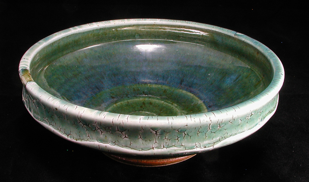 Stoneware bowl with crackle slip, ash glazes.