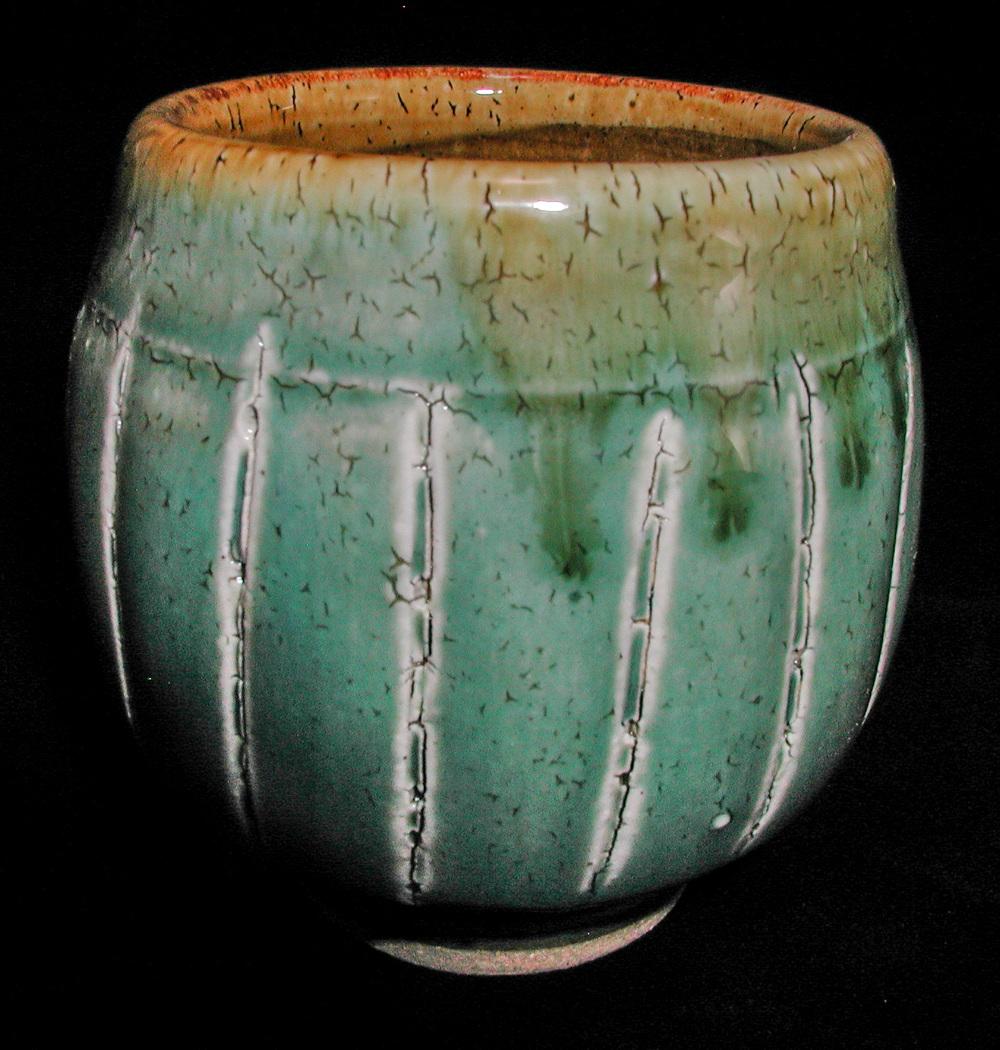 Stoneware Yunomi with crackle slip, green ash glaze, amber ash glaze