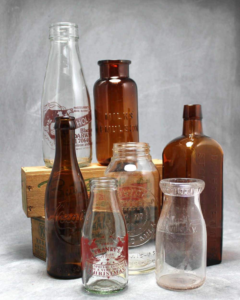 Just a few of my milk bottles and apothecary bottles. I love amber glass, especially for a fall wedding!