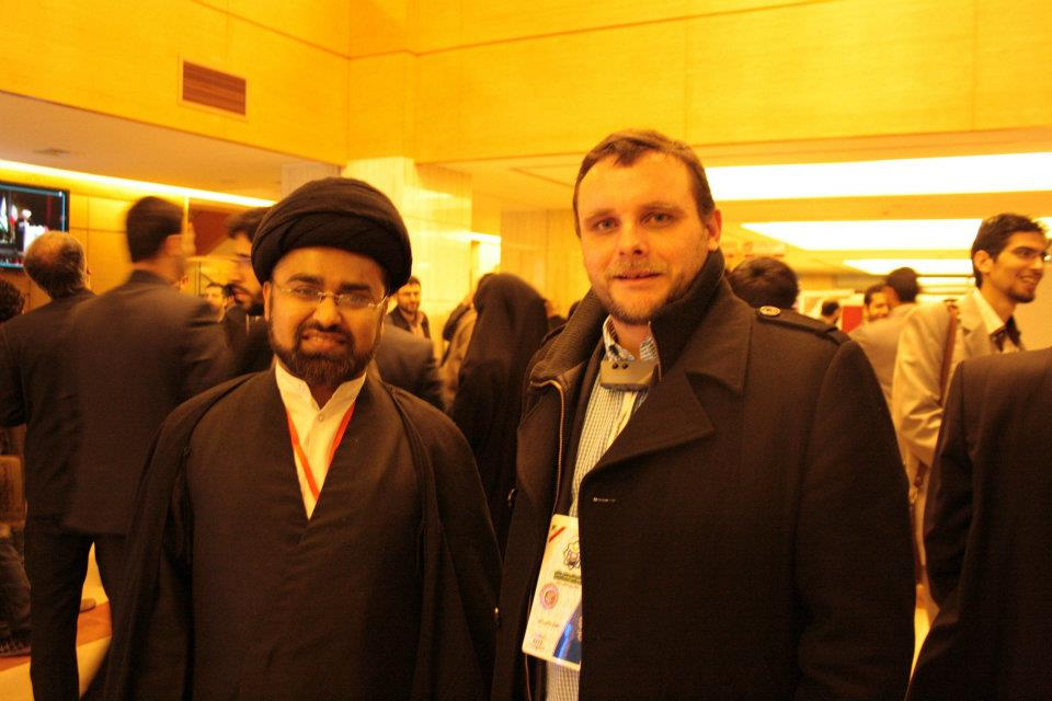 with a Shiite cleric at the Teheran conference in 2012
