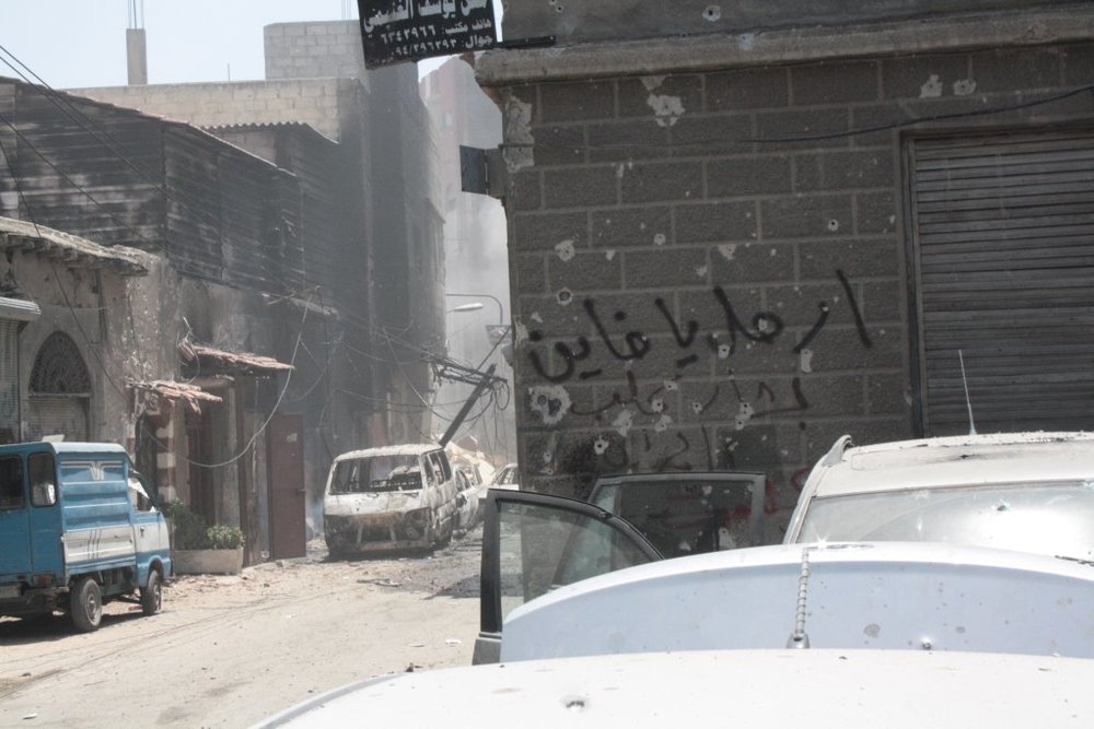 "FSA graffiti in al-Midan, Damascus, 2012: ""Leave, you traitor Bashar, you dog..."""