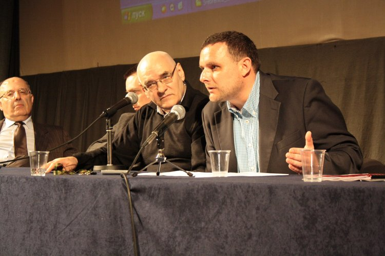 Stefan Karganovic (very left) and me discussing at the Srebrenica Historical Project in 2012