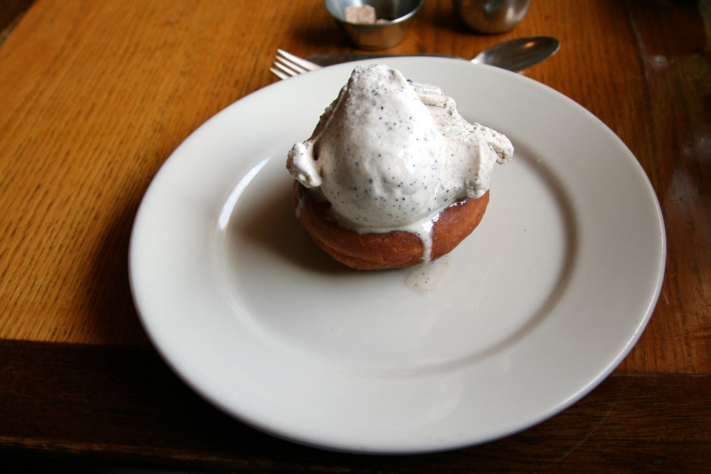 Coffee ice cream on a warm doughnut