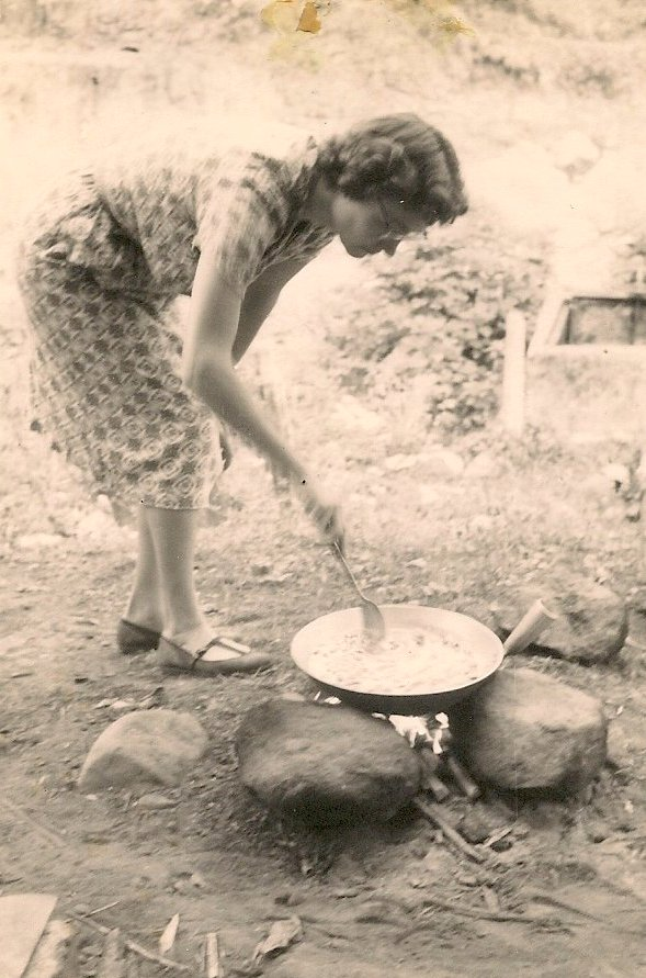Vickie cooking outdoors in Africa.