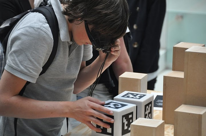 A student examines a box in the exhibition that is covered in AR tags. Image courtesy of the University of Groningen.