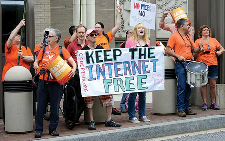 "(Protesters call for equal access at a ""net neutrality"" rally in Washington, DC. Photo: STEPHEN MELKISETHIAN)"