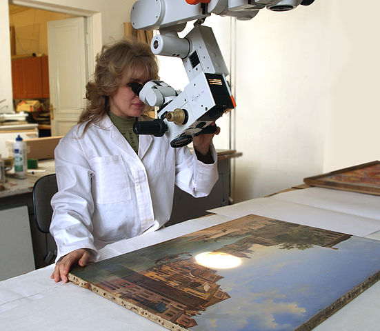 A museum conservator at work