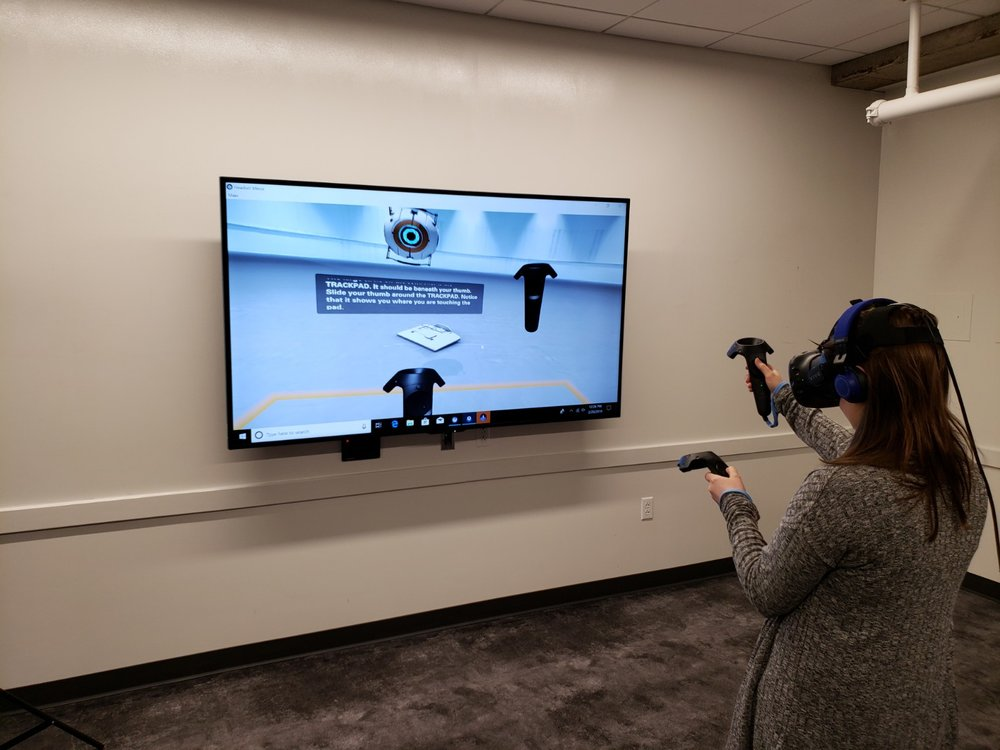 Image: Author using VR contlrolers during the tutorial