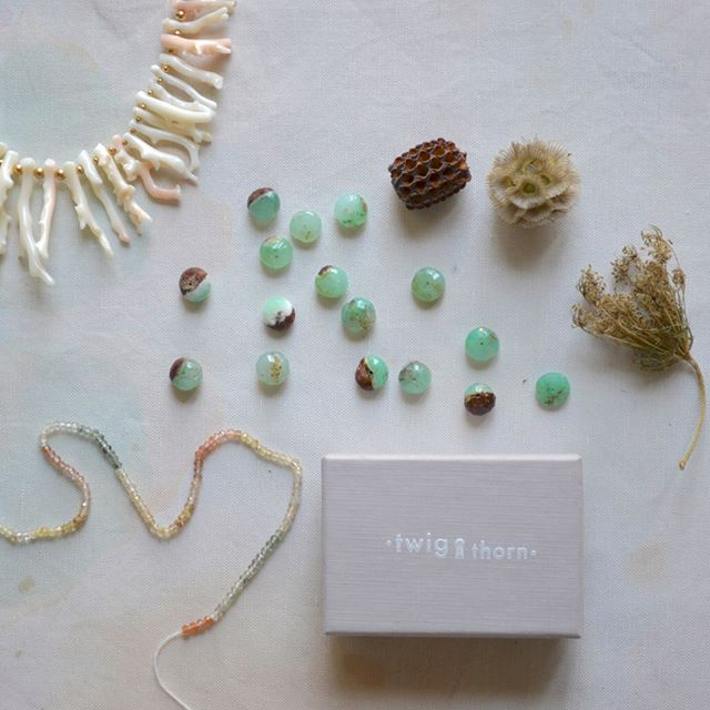 Behind the Scenes:  Working some studio magic today.  Queen Anne's lace and Scabiosa pod meeting Rutilated quartz and chrysoprase.  Hey so nice to meet you!  Unexpected pairings is quintessential to being perfectly imperfect. Come see all of the interesting and gorgeous creations at the link in bio. 🌱 www.twigthorn.com