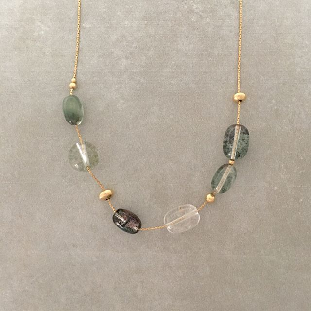Our stunning Green Phantom quartz necklace! Sliding barrels showcase the pools of beautiful green mossy speckles. It's amazing to think Mother Nature does this. She designs everyday. Add this to your collection at the link in bio!🌱 www.twigthorn.com