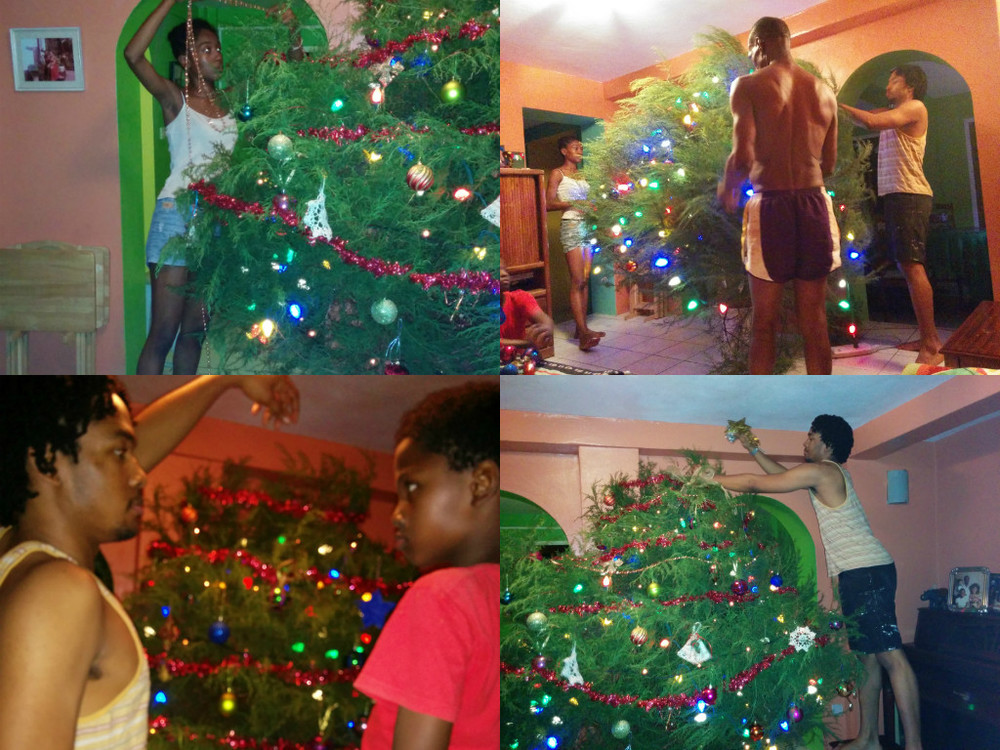 The annual family gathering to decorate the Christmas tree. Malaika, , who is currently in Jamaica doing a 6 week artist residency was sorely missed.