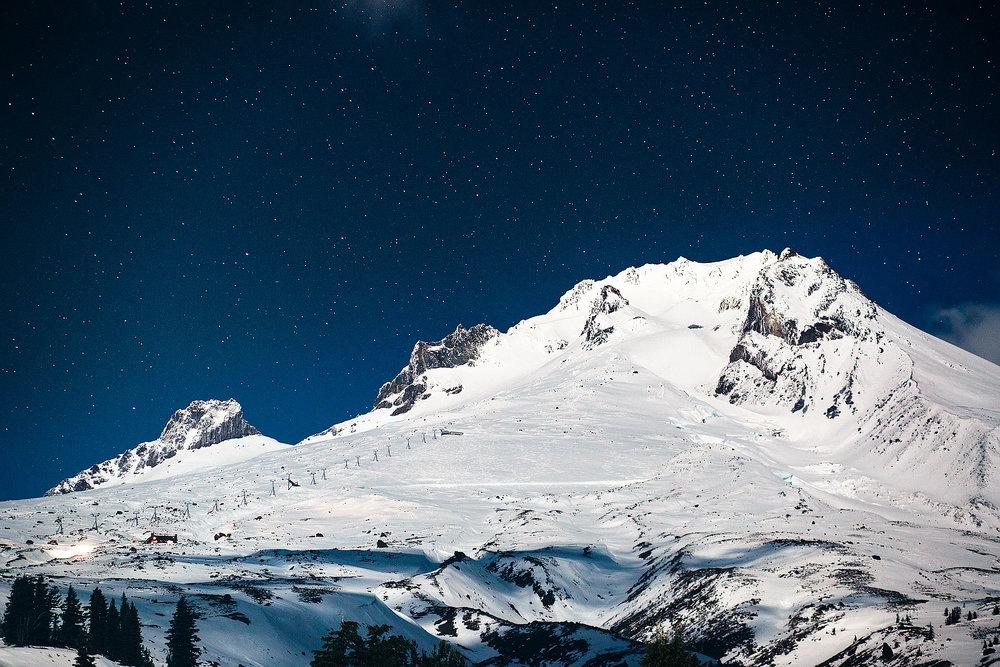 Peak of Mt Hood and Silcox hut under the stars