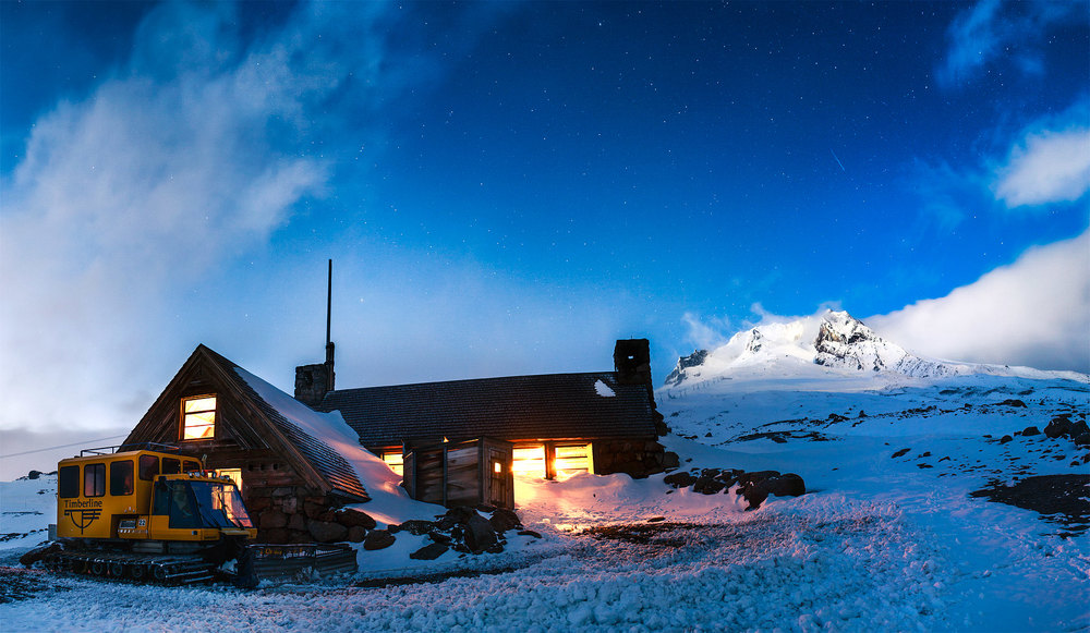 Silcox Hut at sunset as the clouds clear over the summit of Mt Hood