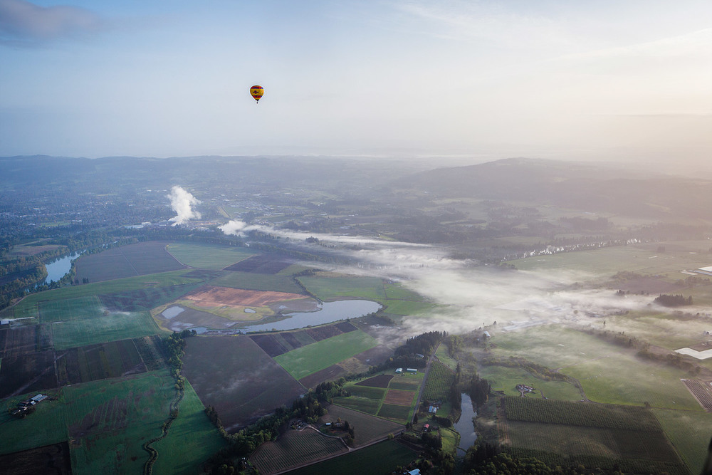 Hot air balloon over a foggy sunrise in St Paul, Oregon