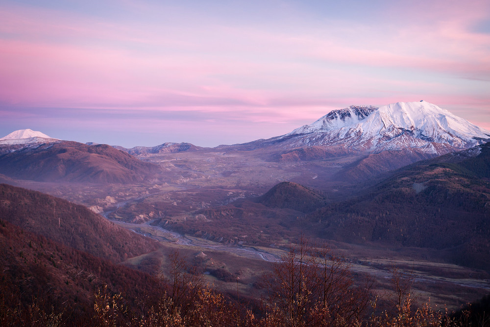 Sunset over Mt St Helens, Washington with the peak of Mt Adam's in the distance.