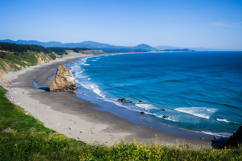 View of the beach and rocks south of Cape Blanco, Oregon