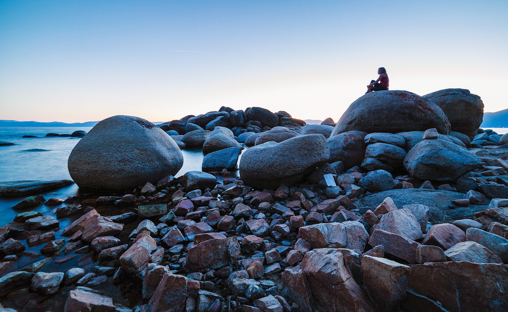 Sitting on the boulders at Bonsai Rock, Lake Tahoe