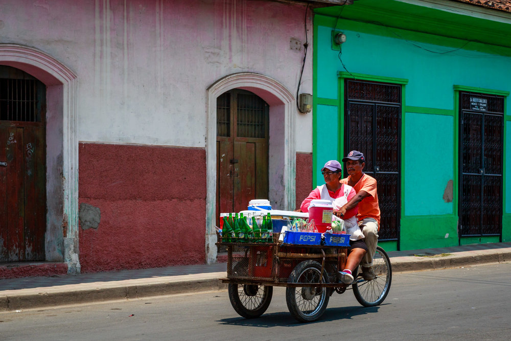 Husband and wife riding into downtown Granada, Nicaragua