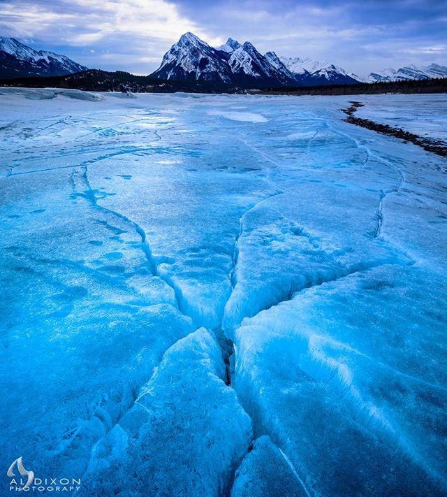 Radiating fractures in the ice of Abraham Lake at Preacher's Point. #photography #art #sky #clouds #ice #mountain #AbrahamLake #PreachersPoint #explorealberta #travelalberta #meanwhileinalberta #canadasworld #ImagesofCanada #landscape #landscape_captures #Canada #Alberta #justgoshoot #Nikon #D810
