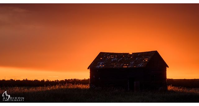 First light sets the sky ablaze over a prairie relic. #photography #art #sky #sunrise #explorealberta #travelalberta #meanwhileinalberta #canadasworld #ImagesofCanada #landscape #landscape_captures #Canada #Alberta #justgoshoot #exploretocreate #peoplescreatives #visualsoflife #rural #rural_love #ruralexploration #rurallife #heritage #farm #farmlife #farming #abandoned #abandonedplaces #Nikon #D810