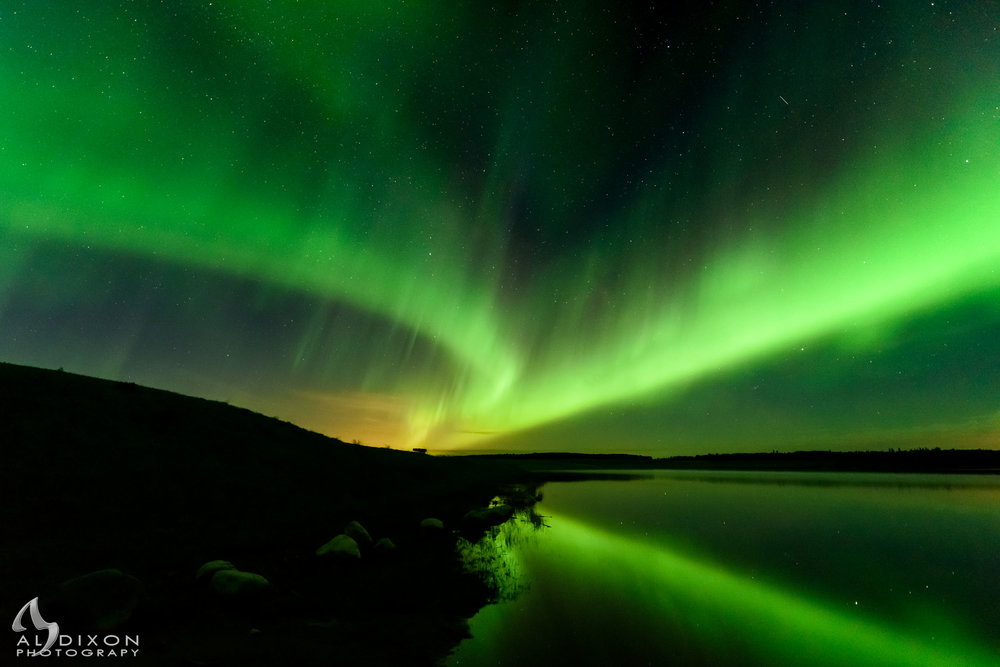 Northern Lights dancing over Paddle River Reservoir in Lac Ste Anne County.