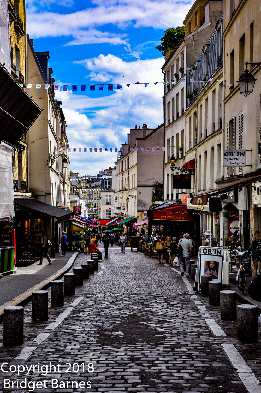Pedestrian-only Rue Mouffetard offers travelers a stress-free opportunity to capture images of market displays and shop windows.